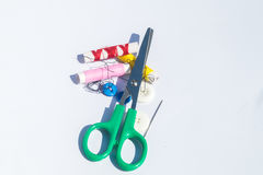 Needle, thread and scissors, sewing items. Hand stitching made up of needle, thread and scissors, sewing items stock photo