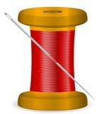 Needle and thread spool Stock Photo