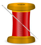 Needle and thread spool. Thread spool and needle on a white background Stock Photo