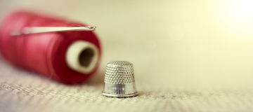 Needle, thread and thimble Royalty Free Stock Images