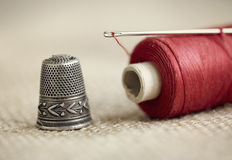 Needle, thread and thimble Royalty Free Stock Image