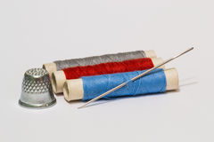 Needle, threads and thimble. Tailoring. Royalty Free Stock Photo