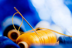 Needle and yellow thread Royalty Free Stock Image