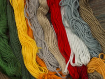 Needlecraft embroidery threads. Creating beautiful colorful background, top view Royalty Free Stock Image