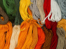 Needlecraft embroidery threads. Creating beautiful colorful background, top view Royalty Free Stock Photo