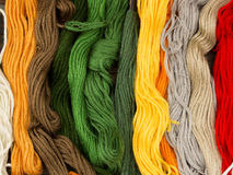 Needlecraft embroidery threads. Creating beautiful colorful background, top view Royalty Free Stock Images