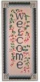 Needlepoint Welcome. Large neddlepoint welcome with hummingbird and twining fushia stock photography