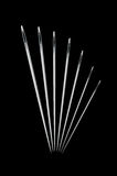 Needles on black. A  illustration of different size needles isolated on black Stock Photos