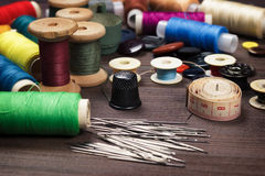 Needles buttons and threads Stock Images