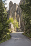 Needles Highway. Winding road with large rock formations. Needles Highway, a National Scenic Byway, passing through impressive granite spires at Custer State stock photo