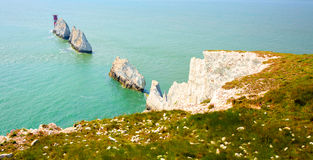 The Needles Isle of Wight landmark by Alum Bay. Chalk stack rocks and lighthouse Stock Photos