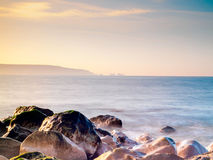 Needles in the Mist. The Needles viewed from Hurst Spit, Milford on Sea Stock Image