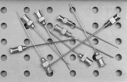 Needles for old  syringes. In metal sterilizer Stock Images