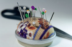 Needles on pin cushion Stock Photos