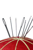 Needles on a red pin cushion Royalty Free Stock Photo
