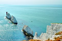 Needles rocks and lighthouse. The Needles is a row of three stacks of chalk that rise out of the sea off the western shore of the Isle of Wight, England Royalty Free Stock Image