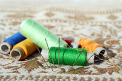The needles and the threads. Much needles and varicoloured threads to rest upon the matters Stock Image