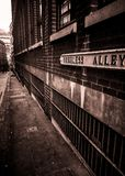Needless Alley Birmingham, vintage look Sepia. Mono looking toward new street, cobbled old street royalty free stock image