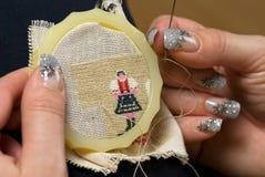 needlework руки Стоковые Изображения