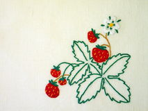 Needlework. With strawberries ornament on white linen fabric Royalty Free Stock Photos