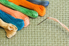 Needlework. Background - texture of cotton canvas for needlework and yarn Stock Image