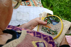 Needlework. Grandmother needlwork stock photo
