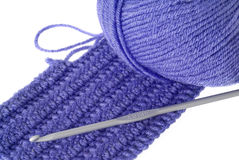 Needlework. Crochet, knitwork and blue yarn on white background Royalty Free Stock Photo
