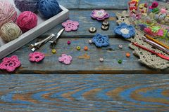 Needlework accessories for creating crocheted jewelry. Beads, threads, hooks, buttons on wooden background. Knitting, crochet, emb. Roidery, sewing Small Royalty Free Stock Image