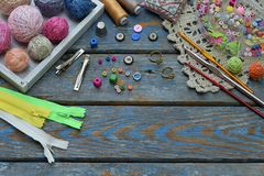 Needlework accessories for creating crocheted jewelry. Beads, threads, hooks, buttons on wooden background. Knitting, crochet, emb. Roidery, sewing Small Royalty Free Stock Photo