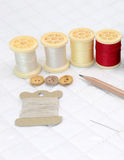 Needlework accessories put on Patchwork Quilt. Basic pattern square Stock Photography