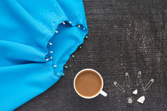 Needlework and coffee on black background Royalty Free Stock Images