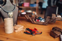 Needlework equipment, pliers, workshop interior. Needlework equipment and tools, pliers, workshop interior. Handicraft accessories. Handmade fashion jewelry Stock Photos