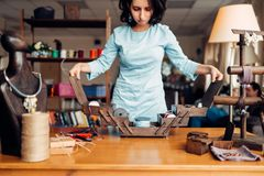 Needlework, female master at workplace in workshop. Needlework tools and equipment, female master at workplace in workshop. Handicraft accessories. Handmade Stock Photography