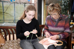 Needlework. Grandmother and her granddaughter doing needlework Stock Images