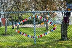 Needlework hanged on a fence Royalty Free Stock Photo