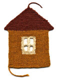 Needlework.Knitted house Stock Images