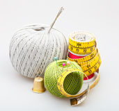 Needlework objects on gray background Stock Photos
