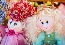 Needlework, original toys in the form of amusing dolls Stock Photos