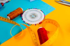 Needlework set, scissors, centimeter tape and sewing needles stock photography