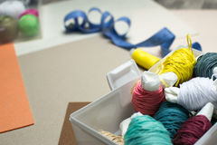 Needlework. Sewing kits with colored thread. Box with colored threads. Sewing kit. Background neutral shades Royalty Free Stock Image