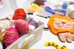 Needlework. Sewing kits with colored thread and handmade soft toys. Sewing kit with colored thread and handmade soft toy tiger, zebra, lion Stock Image