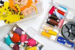 Needlework. Sewing kits with colored thread and handmade soft toys. Stock Photography