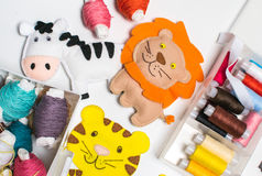 Needlework. Sewing kits with colored thread and handmade soft toys. Royalty Free Stock Photography
