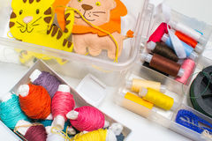Needlework. Sewing kits with colored thread and handmade soft toys. Royalty Free Stock Images