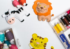 Needlework. Sewing kits with colored thread and handmade soft toys. Royalty Free Stock Photos