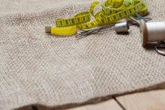 Needlework tools on jute cloth Royalty Free Stock Photo