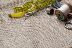 Needlework tools on jute cloth Stock Images