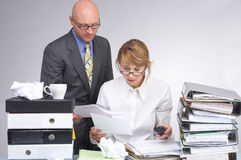 This needs to be done. Boss comes with a lot of paperwork to her assistant royalty free stock image