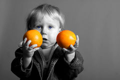 Needs vitamins. Young boy with oranges needs vitamins Stock Photos