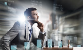 He needs winning strategy    . Mixed media Royalty Free Stock Images